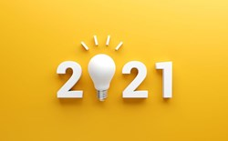 Predictions for AI and ML in 2021-2021 in white against a bright yellow background