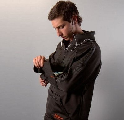 man wearing Wearcom SOMA-1 pullover and using phone in sleeve compartment
