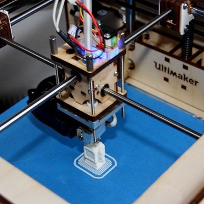 Ultimaker 3D printer printing a white object