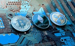 Top three cryptocurrencies Cryptocurrency coins are displayed on a motherboard