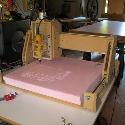 DIY CNC machine cutting a design in pink material