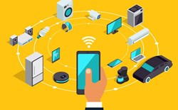 IoT predictions a web of interconnected devices are pictured against a bright yellow background