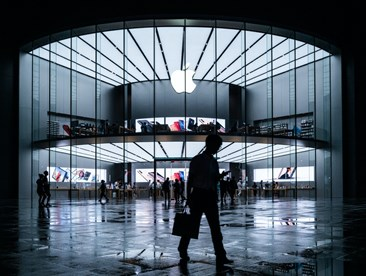 Apple stores in the evening, busy Apple stores and people on the road