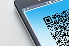 The Danger of QR Codes: A QR code is displayed on the screen of a smartphone