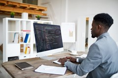 web developer: a person sits in front of his computer